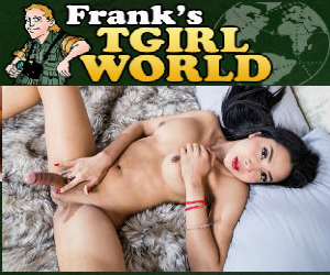 Franks TGirl World logo image. Photo of big cock ladyboy laying on the bed masturbating.